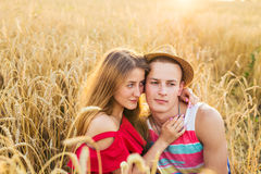 Portrait of romantic couple embraces in the field Stock Images