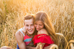 Portrait of romantic couple embraces in the field Stock Photos