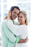 Portrait of romantic couple embracing at home Stock Images