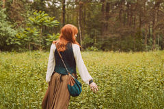 Portrait of romantic hippie woman smile in the woods. Stock Photos