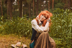 Portrait of romantic hippie woman smile in the woods. Royalty Free Stock Images