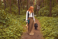 Portrait of romantic hippie woman smile in the woods. Stock Image