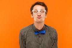 Portrait romantic man, send kiss at camera .Showing lips. Stock Photo