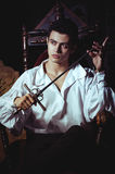 Portrait of a romantic man. With a sword Royalty Free Stock Photo