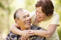 Portrait romantic senior Asian couple outdoors Royalty Free Stock Photo