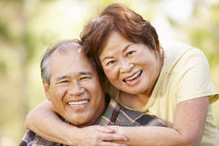 Portrait romantic senior Asian couple outdoors Stock Photo