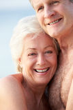 Portrait Of Romantic Senior Couple On Beach Stock Photos