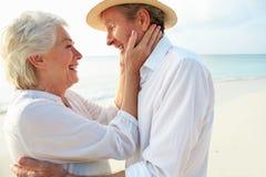 Portrait Of Romantic Senior Couple On Beach Royalty Free Stock Photos