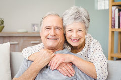 Portrait of romantic senior couple at home Stock Image