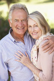 Portrait Of Romantic Senior Couple Relaxing In Countryside Stock Images