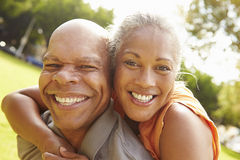 Portrait Of Romantic Senior Couple Relaxing In Park Stock Images
