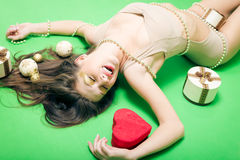 Portrait of romantic sexy young lady having fun enjoying presents relaxing lying on copy space background Stock Images