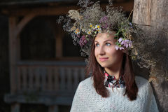 Portrait of a romantic smiling woman in a circlet of flowers. Outdoors Royalty Free Stock Image