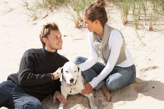 Portrait Of Romantic Teenage Couple On Beach royalty free stock photography