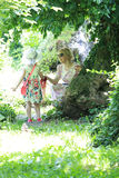 Portrait of romantic woman and daughter in fairy forest Stock Photos