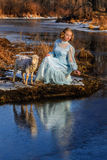 Portrait of romantic woman in a dress on the bank of the river Stock Image