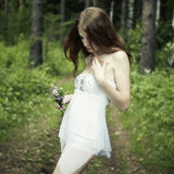 Portrait of romantic woman at fairy forest. Shooting on the nature Stock Photo