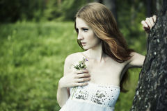 Portrait of romantic woman at fairy forest. Shooting on the nature Royalty Free Stock Photos