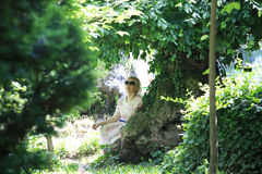 Portrait of romantic woman in fairy forest Stock Image