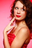 Portrait romantic woman girl in red dress on pink. Valentines Day. Stock Photo