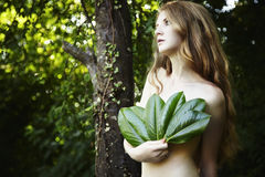 Portrait of romantic woman at the green forest Royalty Free Stock Image