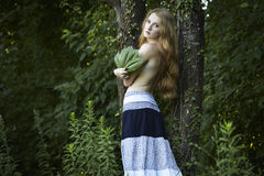 Portrait of romantic woman at the green forest Royalty Free Stock Photos