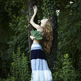 Romantic woman at the green forest Stock Image