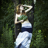 Portrait of romantic woman at the green forest Stock Photography