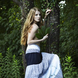 Portrait of romantic woman at the green forest Stock Images