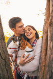 Portrait of romantic young couple with dogs outdoors Royalty Free Stock Photo