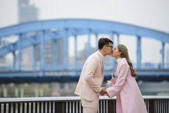 Portrait of romantic young couple kissing on the road.  Royalty Free Stock Photos