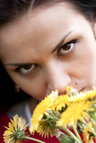 Portrait of a romantic young woman with bouquet. Of dandelions Stock Image