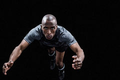 Portrait of rugby player jumping Stock Photo