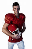 Portrait of rugby player posing with helmet Stock Photos