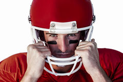 Portrait of rugby player wit hands on helmet Royalty Free Stock Photo