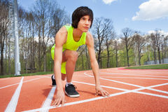 Portrait of runner in start position ready to race Royalty Free Stock Photos
