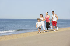 Portrait Of Running Family On Beach Holiday Royalty Free Stock Photography