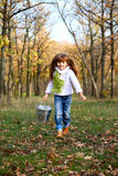 Portrait of running little girl with bucket Royalty Free Stock Image
