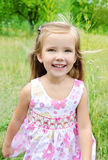 Portrait of running little girl on the meadow Royalty Free Stock Images