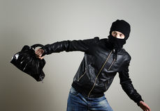 Portrait of running male burglar. With a handbag Royalty Free Stock Images