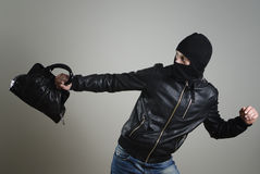 Portrait of running male burglar. With a handbag stock images