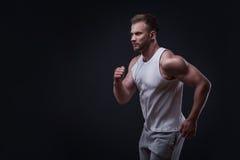 Portrait of running man Stock Photo