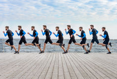 Portrait of a running sport men clones on wooden surface Royalty Free Stock Photos