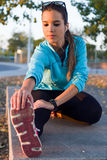 Portrait of running woman doing stretching in the park. Stock Photo