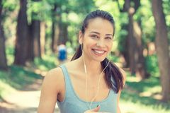 Portrait running young woman. Attractive fitness model outdoors. Royalty Free Stock Image