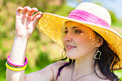Portrait of the rural girl in a straw hat Stock Image