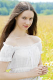Portrait of Russian beauties in a field with flowers Royalty Free Stock Images