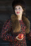 Portrait of Russian fashion style woman with red apple in arm Royalty Free Stock Photos