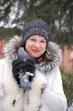 Portrait of the Russian girl with pigeon Royalty Free Stock Images