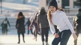 Portrait of Russian skater teen girl skillfully skating on public ice rink. Youth pastime and res stock video footage